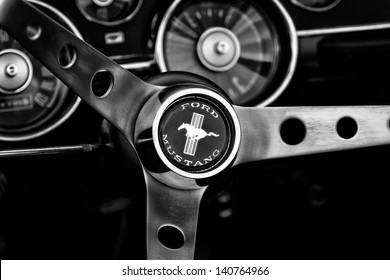 BERLIN - MAY 11: Detail of the steering wheel and dashboard Ford Mustang convertible, first generation (black and white), 26th Oldtimer-Tage Berlin-Brandenburg, May 11, 2013 Berlin, Germany