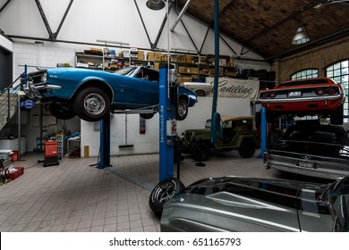 """BERLIN - MAY 13, 2017: Car workshop for maintenance of classic American cars. Center of competence for classic cars and youngtimers - Classic Remise. Exhibition """"Oldtimertage Berlin-Brandenburg"""""""