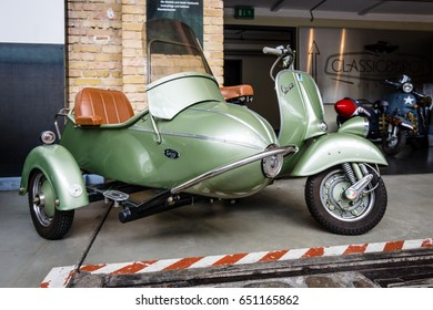 "BERLIN - MAY 13, 2017: Scooter Vespa with Cozy Sidecar. Exhibition ""Oldtimertage Berlin-Brandenburg""."