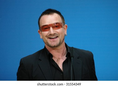 """BERLIN, MAY 14, 2007: Bono (born Paul David Hewson), singer of the Band """"U2"""" smiles into the camera at a meeting with politicians of the Social Democratic Party (SPD) in Berlin."""