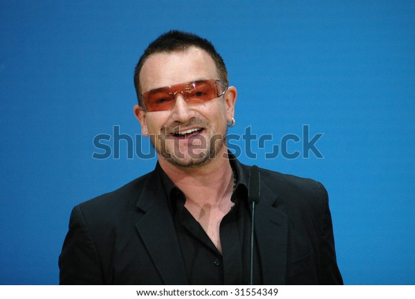 "BERLIN, MAY 14, 2007: Bono (born Paul David Hewson), singer of the Band ""U2"" smiles into the camera at a meeting with politicians of the Social Democratic Party (SPD) in Berlin."
