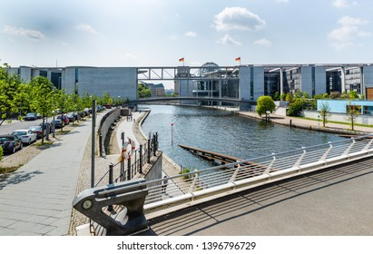 Berlin -  May  18, 2016  -  The Bundeskanzleramt (Federal   Chancellery), and the two pedestrian bridges over the Rive Spree which connects  Paul-Löbe-Haus to the Marie-Elisabeth-Lüders-Haus.