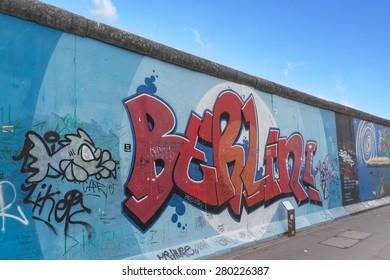 Berlin, May 21, 2015: Berlin graffiti at the Berlin wall / East Side Gallery on May 21, 2015: in Berlin, Germany.