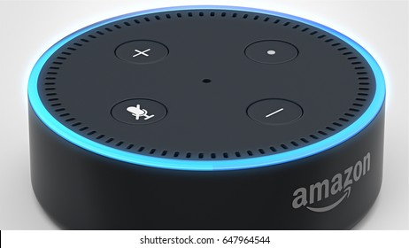 BERLIN - MAY 25, 2017: Amazon Echo Dot 2, Alexa Voice Service activated recognition system photographed on white studio backdrop, Top Angle showing top of device