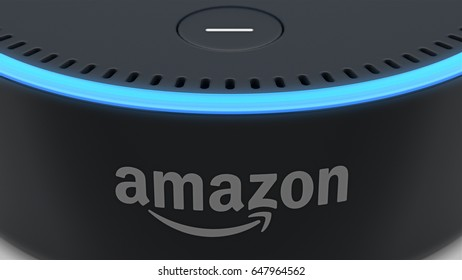 BERLIN - MAY 25, 2017: Amazon Echo Dot 2, Alexa Voice Service activated recognition system photographed on white studio backdrop, Close-Up of Amazon Logo