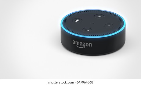 BERLIN - MAY 25, 2017: Amazon Echo Dot 2, Alexa Voice Service activated recognition system photographed on white studio backdrop, Top Right Angled Packshot with room for text