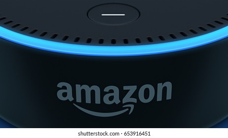 BERLIN - MAY 25, 2017: Amazon Echo Dot 2, Alexa Voice Service activated recognition system photographed on blue studio backdrop