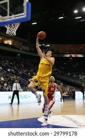 BERLIN - MAY 6: Berlins Casey Jacobsen scores for Alba Berlin at Basketball Bundesliga Match - Alba Berlin vs Paderborn Baskets (82:65) at O2World May 6, 2009 in Berlin.