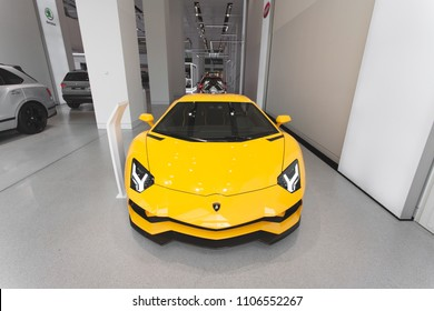 Berlin, Mitte, 2018 - Lamborghini Aventador in yellow, in a showroom, front perspective