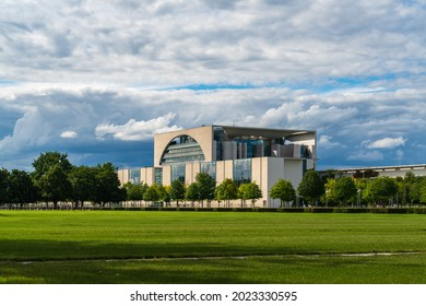 Berlin Mitte, office of the Federal Chancellor of Germany, Bundeskanzleramt. German chancellery, more faithfully translated as Federal Chancellery. Panoramic view with meadow. Sunny with dramatic sky.