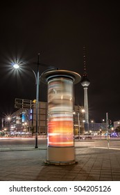Berlin in the night, 10-22-2016 - Berlin-Mitte at the Alexanderplatz with the television tower and a rotating advertising column