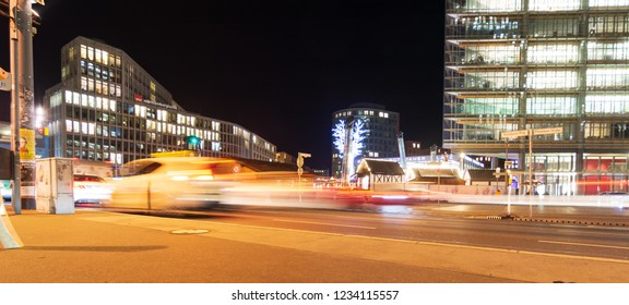 BERLIN - NOV. 15, 2018: People and cars on a night out in Portsdamer Platz, one of the hottest hangouts in the center of Berlin - action shot