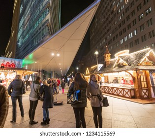 BERLIN - NOV. 15, 2018: People on a night out in Portsdamer Platz, one of the hottest hangouts in the center of Berlin - Slow motion shot