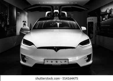 BERLIN - NOVEMBER 09, 2016: Showroom. The full-sized, all-electric, luxury, crossover SUV Tesla Model X. Black and white. Produced since 2016.