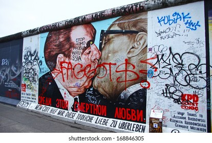 BERLIN - NOVEMBER 10: Fragment of East Side Gallery on November 10,2013 in Berlin. It's a 1.3 km long part of original Berlin Wall which collapsed in 1989 and now is the largest world graffiti gallery