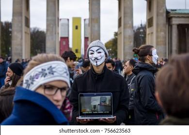 "BERLIN - NOVEMBER 12, 2017: Street action of Berlin Vegans ""Cube of Truth"" in the Anonymous mask near Brandenburg Gate."