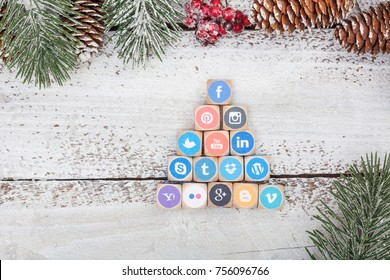 BERLIN, NOVEMBER 14, 2017 - Set of popular social media internet website brand logos printed on wood cubes on white table with Christmas decoration.