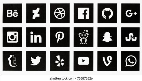 BERLIN, NOVEMBER 14, 2017 - Set of most popular social media internet website brand logos printed in black and white on paper.