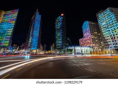 BERLIN - OCTOBER 07, 2018: Modern skyscraper at Potsdamer Platz in brightly colored illuminations. Festival of lights 2018.