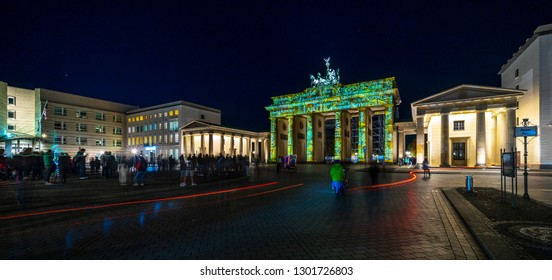 BERLIN - OCTOBER 07, 2018: Pariser Platz and Brandenburg Gate in brightly colored illuminations. Festival of lights 2018.