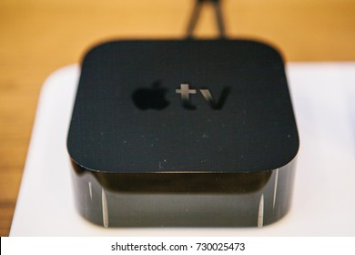 Berlin, October 2, 2017: presentation of new Apple products in the official Apple store. Modern advanced block Apple TV lies on the table.