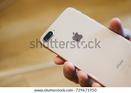 Berlin, October 2, 2017: presentation of the iPhone 8 and iPhone 8 plus and sales of new Apple products in the official Apple store in Berlin. The buyer holds a new iPhone 8 plus.