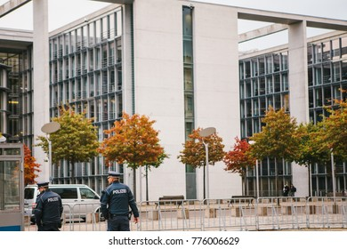 Berlin, October 2, 2017: Two policemen are patrolling. Police presence on the streets of the city. Protection of public order and protection of citizens. Law and order.