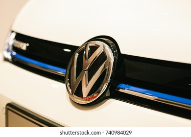 Berlin, October 2, 2017: Volkswagen Group Forum - auto show in Berlin. Close-up - the front of the white Volkswagen car with the company logo