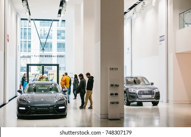 Berlin, October 2, 2017: Volkswagen Group Forum - auto show in Berlin. Buyers and visitors are watching the new sports cars.