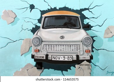 BERLIN - OCTOBER 23: Painting of Birgit Kinder - Trabant car breaking through Berlin Wall at East Side Gallery on OCTOBER 23, 2011 in Berlin.