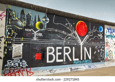 BERLIN - OCTOBER 3, 2014: The Berlin wall with grafitti on October 3, 2014 in Berlin, Germany. It was a barrier that existed from 1961 through 1989 to completely cut off West Berlin from East Germany.