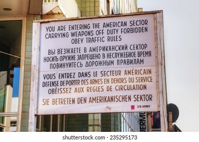 BERLIN - OCTOBER 4, 2014: Historical sign at Checkpoint Charlie on October 4, 2014 in Berlin, Germany. The name was given by the Western Allies to the best-known Berlin Wall crossing point.