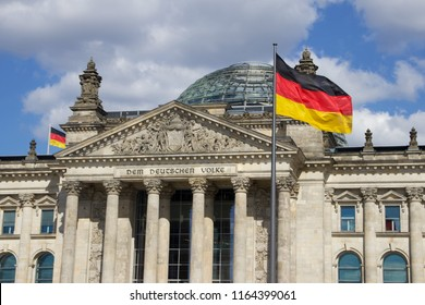 Berlin Reichstag Building with German Flag Waving in Foreground