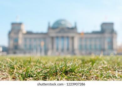 Berlin Reichstag defocused behind meadow -  German Bundestag, government building