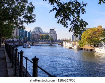 Berlin Reichstag and ship on Spree river