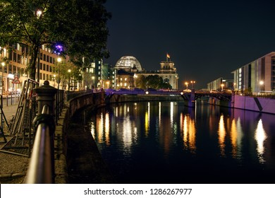 Berlin Reichstag and Spree river at night