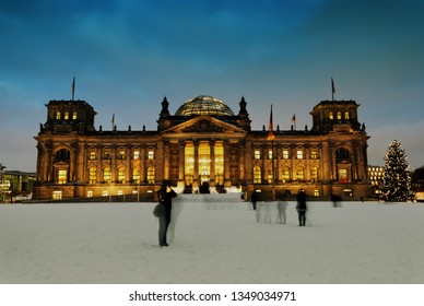 Berlin Reichstag in winter at night and a lot of snow