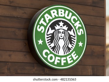 BERLIN - SEPT 10: The Starbucks Coffee sign on the wooden texture in Berlin on September 10. 2016 in Germany