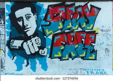 BERLIN - SEPTEMBER 09: East Side Gallery. Stay Free by Christopher Frank, September 09, 2012 in Berlin, Germany. It is a 1,3 km long part of original Berlin wall, famous memorial.