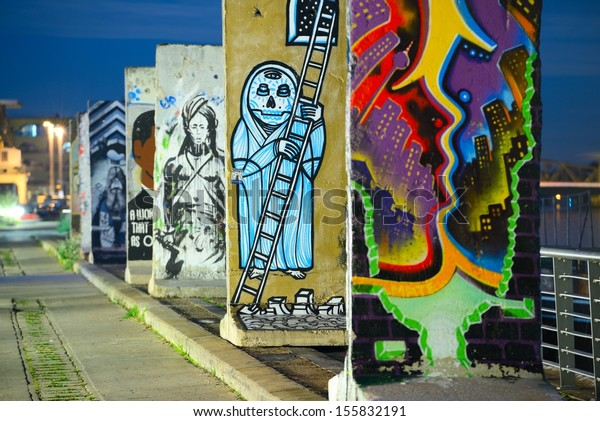 BERLIN - SEPTEMBER 19: Pieces of the Berlin Wall September 19, 2013 in Berlin, Germany. The wall was dramatically taken down in 1989.
