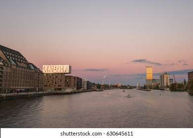 Berlin skyline, river spree panorama, boats and sunset sky
