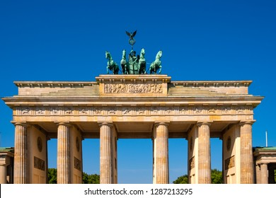 Berlin, Berlin state / Germany - 2018/07/31: Closeup of the Quadriga with Victoria goddess of victory sculpture atop the Brandenburg Gate - Brandenburger Tor - at Pariser Platz square in West Berlin