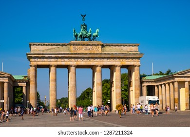 Berlin, Berlin state / Germany - 2018/07/31: Panoramic view of the Brandenburg Gate - Brandenburger Tor - at Pariser Platz square in historic quarter of West Berlin