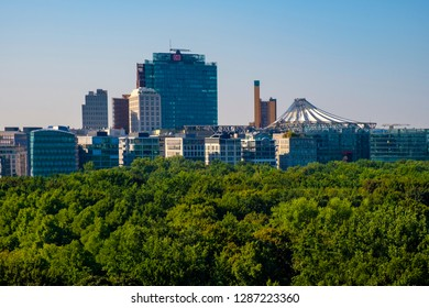 Berlin, Berlin state / Germany - 2018/07/31: Panoramic view of the Groser Tiergarten park and modern architecture of Potsdamer Platz square with German Film museum - Deutsche Kinemathek Museum