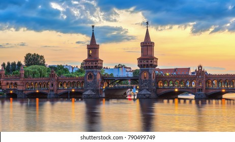 Berlin sunset city skyline at Oberbaum Bridge and Spree River, Berlin, Germany
