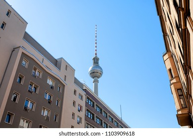 Berlin Television Tower, perspective from a downtown street, with historic buildings, on a clear, sunny day