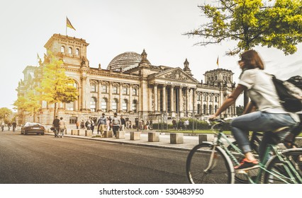 Berlin urban city life with famous Reichstag building in the background in beautiful golden evening light at sunset in summer with retro vintage Instagram style pastel toned filter effect, Germany