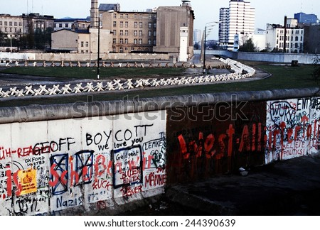 The Berlin Wall separated Communist-controlled East Germany from West Berlin. White apartments of West Berlin contrast with the boarded up vacant brick buildings of East Berlin. June 1 1983.