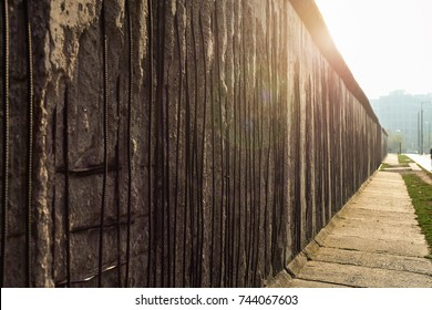 The Berlin Wall with a sun flare. The wall divided the city of Berlin into east and west from 1961 to 1989.