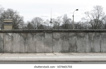 Berlin wall with tower and watchtower